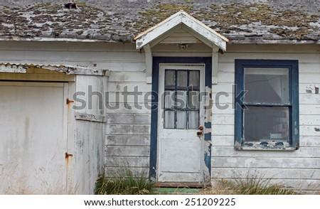 Old Abandoned Weathered White House - stock photo