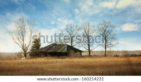 Old abandoned wooden house in the village - stock photo