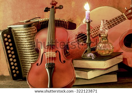Old acoustic music instrument on still life style - stock photo