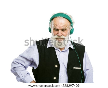 Old active bearded man with headphones listening to music isolated on white background - stock photo