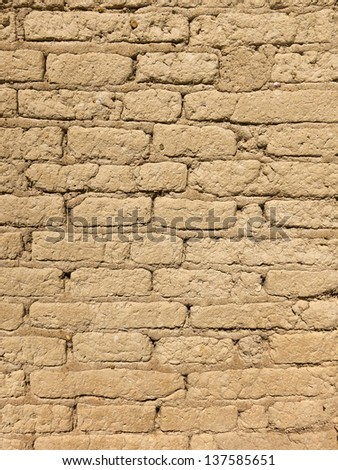 Old adobe brick wall detail for Background or Texture. Macro shot.