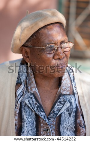 old african granny with glasses, outdoor shot - stock photo