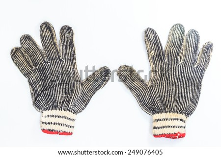 old aged gloves on white background - stock photo