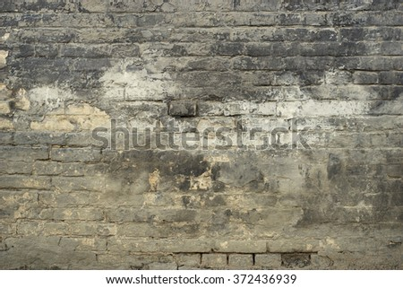 Old aged peeled worn brick wall texture background.  - stock photo