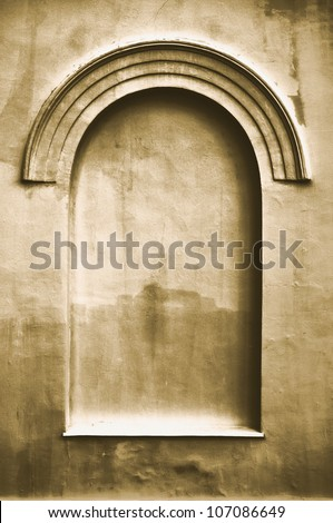 Old aged plastered faux arch false fake window stucco frame background copy space, light dark beige sepia texture - stock photo