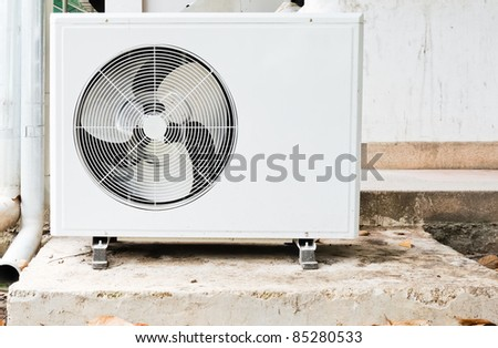 Old air compressors are located outside the conference room. - stock photo