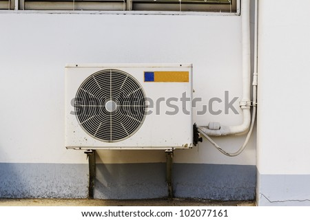 Old air compressors are located outside the operation of industry - stock photo