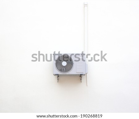 Old air cooled condenser mounted outside the building. - stock photo