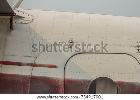 Old airplane door details. Rivets, seams, cups. Dirt, oil trails texture.