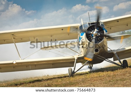 Old airplane ready to start - stock photo