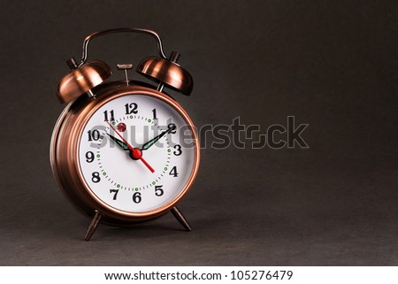 Old alarm clock - stock photo