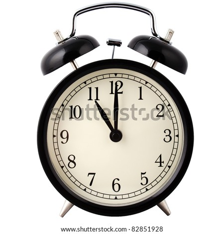 Old Alarm Clock, in black and white, showing eleven o'clock. - stock photo