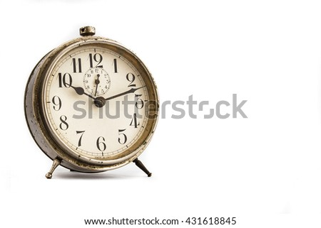 Old alarm clock, isolated on the white background