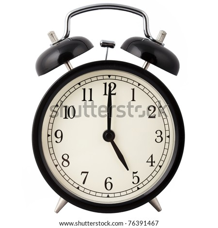 Old Alarm Clock isolated on white, in black and white, showing five o'clock.