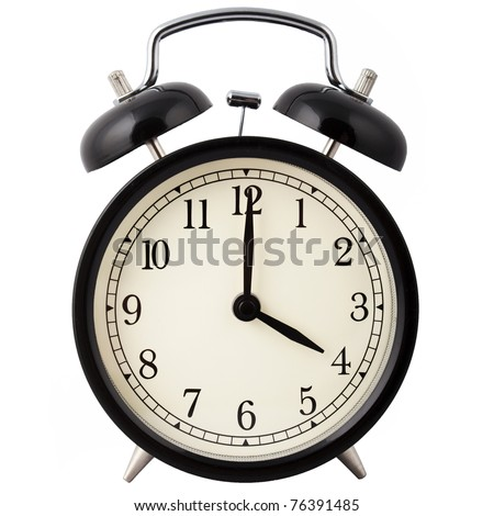 Old Alarm Clock isolated on white, in black and white, showing four o'clock.