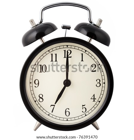 Old Alarm Clock isolated on white, in black and white, showing seven o'clock.
