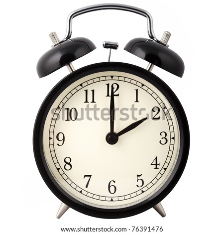 Old Alarm Clock isolated on white, in black and white, showing two o'clock. - stock photo