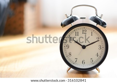 Old alarm clock suggesting deadline concept - stock photo