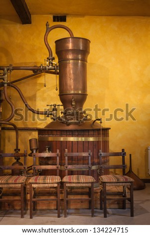 Old alembic  to distill wine - stock photo