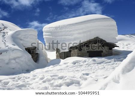old alpine chalet snowbound - stock photo