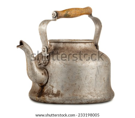 Old aluminum kettle with wooden handle isolated on white background