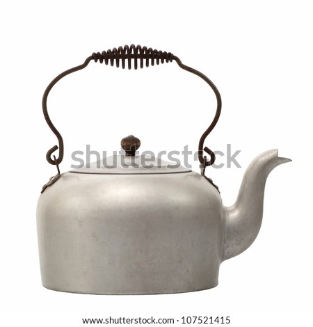 Old aluminum tea kettle with lid on white background - stock photo