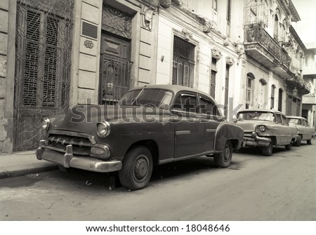 Old American cars in Havana Cuba - stock photo