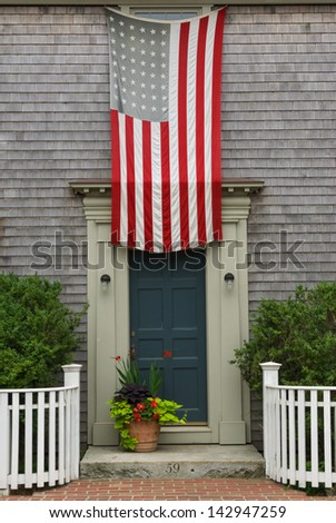 Old American Flag Above Door - stock photo