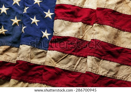 Old American flag background for Memorial Day or 4th of July - stock photo