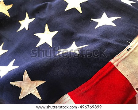 Old American flag flown during a battle
