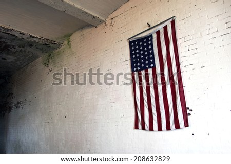 Old American flag on a wall - stock photo
