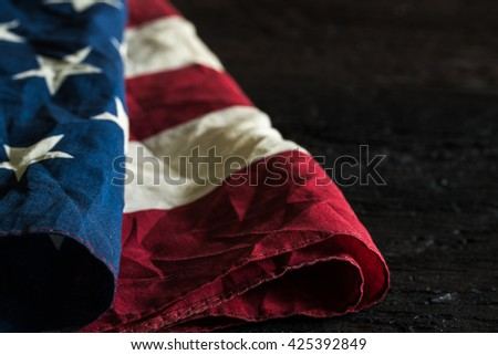 Old American flag on dark background for Memorial Day or 4th of July or Dependence Day, effect by vintage style,vintage image, vintage tone - stock photo