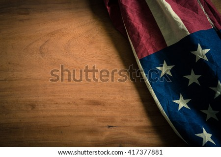 Old American flag on wood background for Memorial Day or 4th of July or Dependence Day