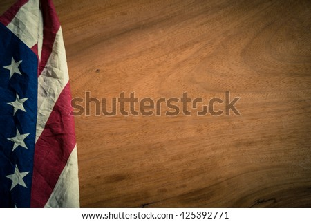 Old American flag on wood texture background for Memorial Day or 4th of July or Dependence Day, effect by vintage style, vintage image, vintage tone - stock photo