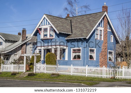 old American luxury suburbs home with blue sky - stock photo