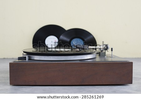 old analog turntable playing record  - stock photo
