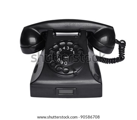 Old analogue black phone. - stock photo