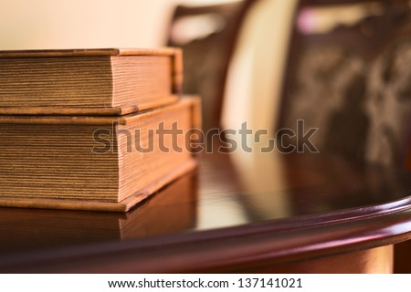 Old ancient book composition over the table as a home interior background - stock photo