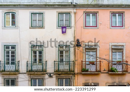 Old ancient house exterior with balcony  - stock photo