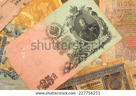 Old ancient money background - stock photo