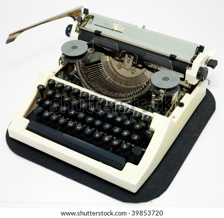 Old ancient typewriter on a white background