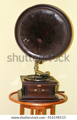 Old ancient vintage gramophone on white background - stock photo