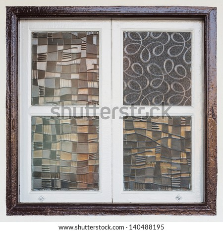 Old and abstract glass window in old building - stock photo