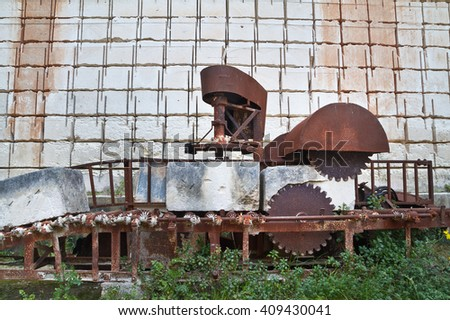 Old and avandoned machinery in Lithica quarry in Menorca, a sandstone block production place since prehistory. - stock photo