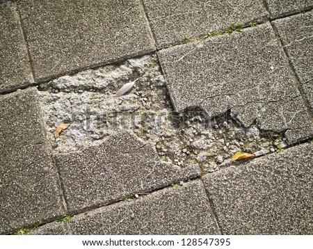 Old and broken asbestos floor tiles - stock photo