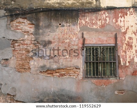 old and broken brick in heritage houses in Penang-Malaysia - stock photo