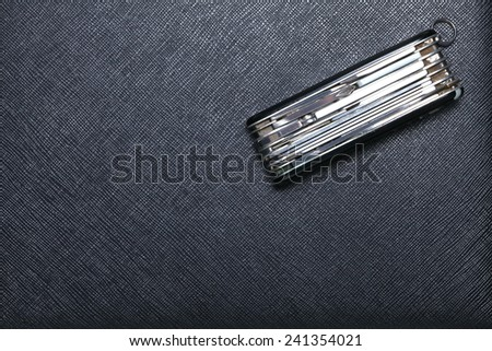 Old and classic stainless steel utility knife set put on black color leather surface background represent the knife equipment. - stock photo