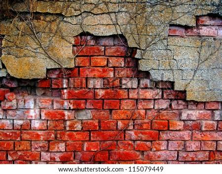 Old and damaged brick wall - stock photo