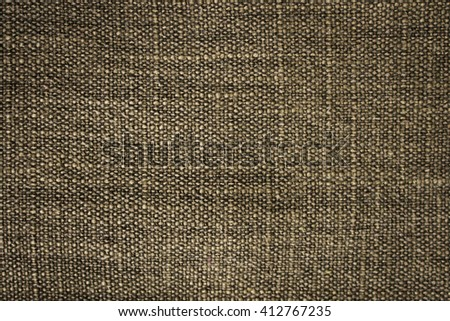 Old and dark fabric textile or sackcloth textured for background. - stock photo