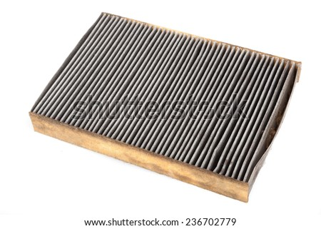 Old and dirty car filter - air cabin filter - stock photo
